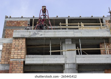 BELGRADE, SERBIA - MARCH 19: Cosntruction workers using electric construction scaffolding lifting winch hoist. At construction site in March 2015.