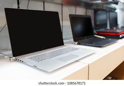 Belgrade, Serbia - March 21, 2018: New HP laptop computers with blank screen are on display in electronic store.
