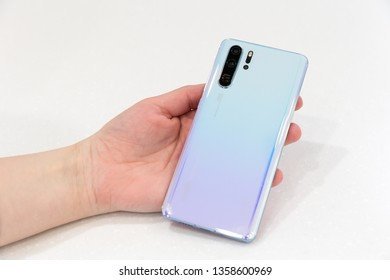 Belgrade, Serbia - March 27, 2019: New Huawei P30 Pro mobile smartphone is displayed from rear side in hand. Flagship gadget with Leica camera on isolated white background.