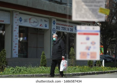 BELGRADE, SERBIA - MARCH 28, 2020: Man with mask. As the Corona Virus continues to spread all over Serbia, government imposed curfew to prevent the spread of coronavirus disease.