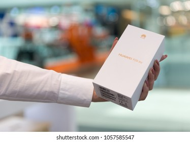 Belgrade, Serbia - March 29, 2018: New Smartphone, Huawei P20 lite, in original box, is holded with a hand.