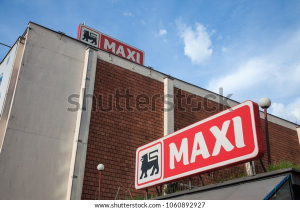 BELGRADE, SERBIA - MARCH 30, 2018: Entrance of a Maxi Supermarket with its logo. Belonging to the Belgian group Delhaize, Maxi Supermarkets is the leader in mass market retailing in Serbia