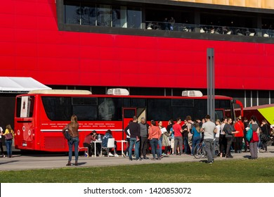 Belgrade, Serbia - March 30, 2019: People waiting in front of the transfusion bus to donate blood. Blood units are always in need. Transfusion bus in front of Shopping Center Usce.