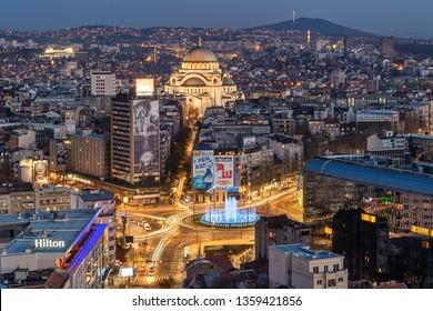 Belgrade, Serbia March 31, 2019: Panorama of Belgrade at night. Belgrade downtown skyline with temple of Saint Sava, new fountain, Hotel Slavija and Slavija square.