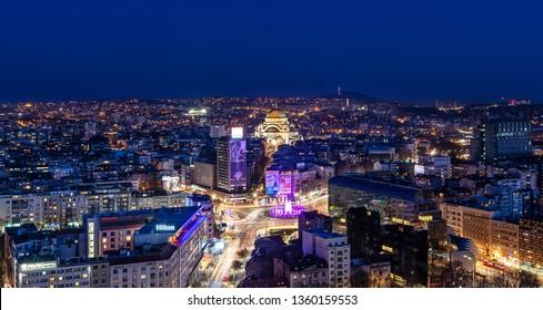 Belgrade, Serbia March 31, 2019: Panorama of Belgrade at night. The photo shows the Slavija Square, the Belgrade municipality of Vracar, new music fountain and the temple of St. Sava.