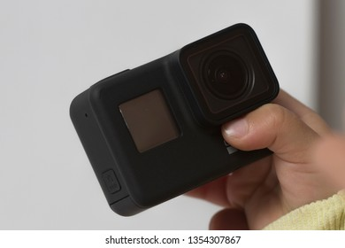 Belgrade, Serbia - Mart, 30 2019: GoPro Hero 7 Black action camera in the hand of a boy isolated on the white background.