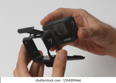 Belgrade, Serbia - Mart, 30 2019: Man holds GoPro Hero 7 Black action camera and the frame isolated on the white background.