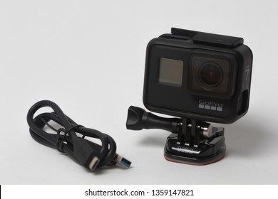 Belgrade, Serbia - Mart, 30 2019: GoPro Hero 7 Black action camera with the frame and cable isolated on the white background.