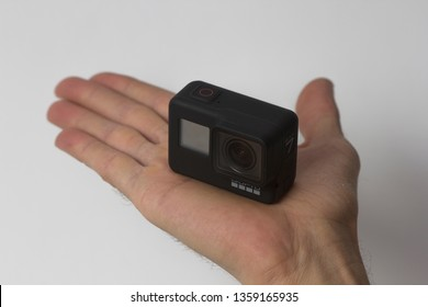 Belgrade, Serbia - Mart, 30 2019: GoPro Hero 7 Black action camera in the male hand isolated on the white background.