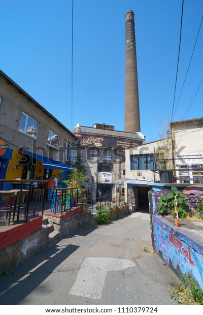 Belgrade, Serbia - May 02, 2018: Bars and restaurants on Cetinjska street with view on old red brick chimney