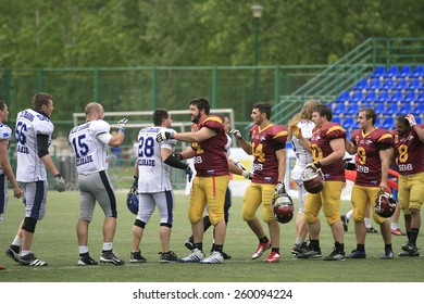 Belgrade, Serbia - May 05, 2014: Teams are welcome among themselves. American Football Match Between Belgrade Wolves And Blue Dragon in Belgrade. The Wolves team is winner.