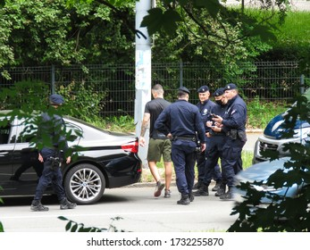 Belgrade, Serbia, May 15, 2020. A police officers wear protective mask, as one of the measures in the fight against Covid-19 virus, stops and legitimizes a citizen in vehicle in the street.