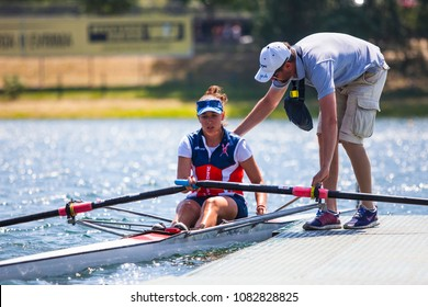 Belgrade, Serbia - May 2, 2018; Athlete on a Serbian Cup Rowing Competition consulting with her coach