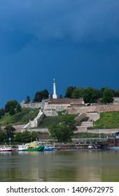 BELGRADE, SERBIA - MAY, 2019: Belgrade fortress in stormy weather, Pobednik monument (Victor) Belgrade, Serbia