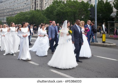 BELGRADE, SERBIA - MAY 21: collective wedding on May 21, 2017 in Beograd, Serbia. This collective wedding was created during the Kosovo war for a sign of love in Belgrade.