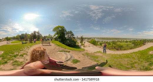 Belgrade, Serbia - May 25, 2019 :  Tourists on hillside of Kalemegdan Fortress overlooking confluence of Sava and Danube Rivers on sunny day.