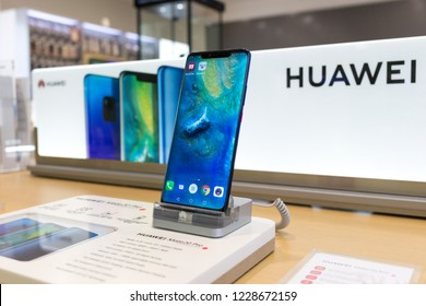Belgrade, Serbia - November 08, 2018: New Huawei Mate 20 Pro mobile smartphone is shown on retail display in electronic store. Close-up look at mobile gadget, brand logo in the background