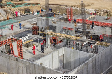 BELGRADE, SERBIA - NOVEMBER 11: Bird view of concrete foundation with reinforcement rods and workers. At construction site in November 2014.