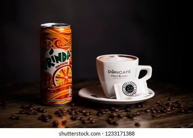 BELGRADE, SERBIA , NOVEMBER 13 2018 :  cup of coffee with mirinda juice.