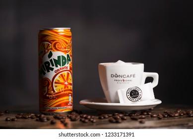 BELGRADE, SERBIA , NOVEMBER 13 2018 :  cup of coffee with mirinda juice.