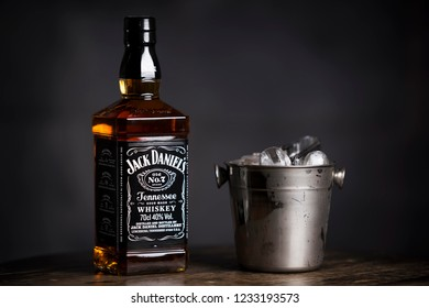 BELGRADE, SERBIA , NOVEMBER 13 2018 :  Bottle of Jack Daniel's isolated on wooden table. Whiskey drink