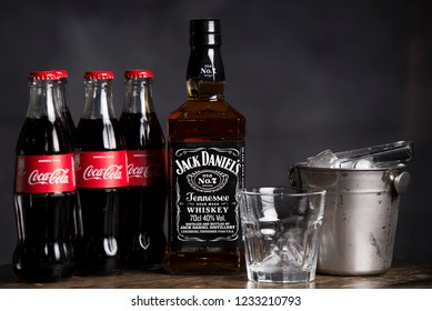 BELGRADE, SERBIA , NOVEMBER 13 2018 :  Bottle of Jack Daniel's with coca cola drink.