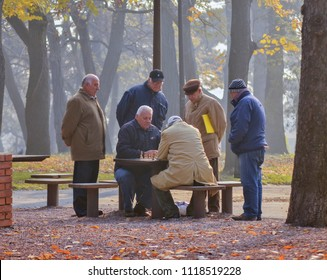 Belgrade, Serbia - November 17, 2011: A group of pensioners are watching how two elderly people play chess in Kalemegdan Park