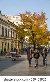 Belgrade, Serbia - November, 2, 2014: The old street Skadarlija in Belgrade, Serbia, people, yellow autumn trees