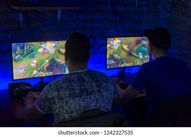 BELGRADE, SERBIA , NOVEMBER 26 2018 :  people from behind playing league of legends. LoL players in the game