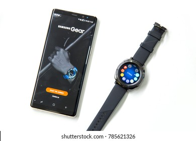 BELGRADE, SERBIA - November 28, 2017: Samsung Gear S3 smartwatch and phone on a white background.