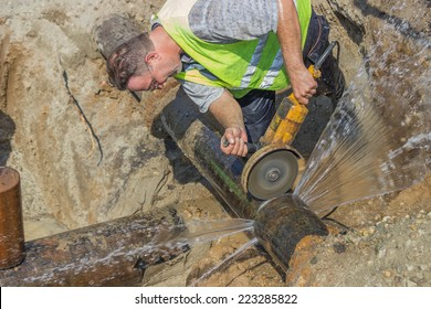 BELGRADE, SERBIA - OCTOBER 01: Close of cutting section of water main pipe for installation new valve. Teeing into a water main. At street Vojvode Stepe in October 2014.
