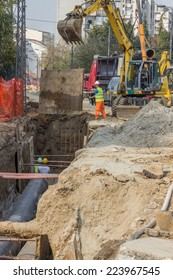BELGRADE, SERBIA - OCTOBER 01: Digging the trenches for the ground heating pipes and shoring supports. Excavators dig trenches. Selective focus. At street Vojvode Stepe in October 2014.