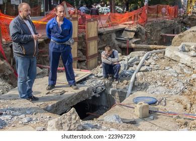 BELGRADE, SERBIA - OCTOBER 01: Utility crew fixing broken water main. Teeing into a water main. At street Vojvode Stepe in October 2014.