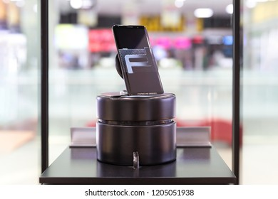 Belgrade, Serbia - October 03, 2018: Huawei Mate RS Porsche design smartphone is displayed on demo stand in electronic store. Premium mobile device in retail on isolated background.