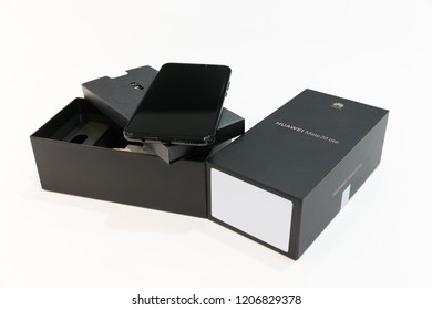 Belgrade, Serbia - October 03, 2018: Huawei Mate 20 Lite mobile smartphone is displayed with original box opened on isolated white background.