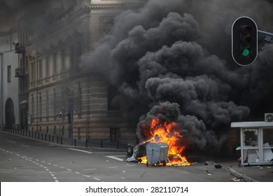 Belgrade, Serbia - October 10, 2010: a police car is on fire during the gay pride parade