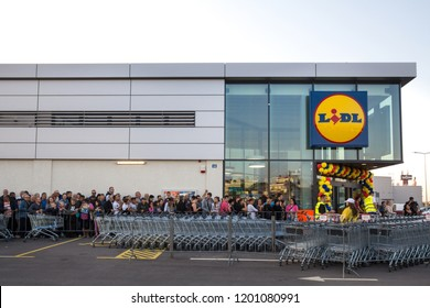 BELGRADE, SERBIA - OCTOBER 11, 2018:  Crowd waiting in queue for the grand opening ceremony of the 1st Lidl supermarket in Serbia. Lidl is a German global discount supermarket chain
