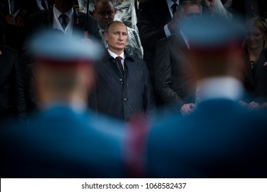 Belgrade, Serbia - October 16, 2014: Russian President seen through the soldiers during the military parade March of the victorious in Belgrade. President Vladimir Putin of Russia arrived in Belgrade
