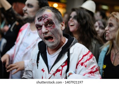 Belgrade, Serbia - October 19, 2013: People masked as zombies parades on streets during a zombie walk. Zombie walk is organized before Serbian SF movie festival.