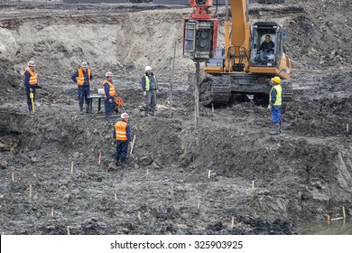 BELGRADE, SERBIA - OCTOBER 19, 2015: Engineers and soil technicians driling for standard penetration tests and sampling through soil. Site Investigations for the Belgrade Waterfront project.
