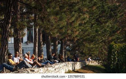 Belgrade, Serbia - October 20, 2017: People sitting on the bench in the park. Kalemegdan, Serbia