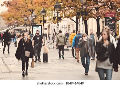 Belgrade, Serbia - October 2020: People wearing face protective masks on the street of Belgrade on autumn day, Serbia