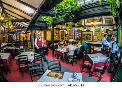 BELGRADE, SERBIA - OCTOBER 21, 2017: Interior with paintings on restaurant walls, located in the old street Skadarlija, the main bohemian place of Belgrade.