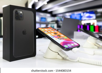 Belgrade, Serbia - October 25, 2019: New Apple iPhone 11 Pro mobile smartphone is shown with apps on the screen on retail display in electronic store. Original package close up.
