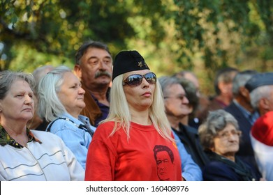 Belgrade, Serbia - October 26, 2013: Woman with a shirt Tito at the funeral of Jovanka Broz. Jovanka Broz, Yugoslavia's former First Lady built by her husband Josip Broz Tito in the House of Flowers mausoleum.