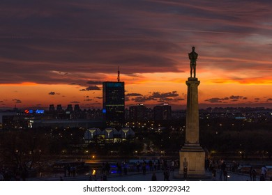 Belgrade, Serbia - October 27, 2018: Beautiful sunset and city skyline over Belgrade, Victor monument on Kalemegdan fortress, symbol and landmark of the city and New Belgrade.