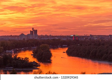 Belgrade, Serbia - October 27, 2018: Dramatic, colorful city sunset. Beautiful city skyline. The sky is on fire. Sunset over river. Danube and Sava rivers confluence.