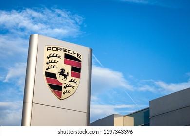 BELGRADE, SERBIA - OCTOBER 7, 2018: Porsche logo on their main dealership store in Belgrade. Porsche is a German car and automotive manufacturer, specialized in luxury sports vehicles