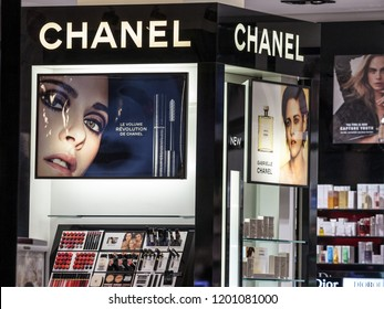BELGRADE, SERBIA - OCTOBER 8, 2018:  Logo of Chanel seen in their Belgrade main store at night. Coco Chanel, is a European luxury goods company famous for its perfumes