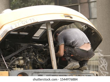 Belgrade, Serbia / Republic of Serbia - October, 10th, 2019.: A man on the truck in the street trying to repair the engine